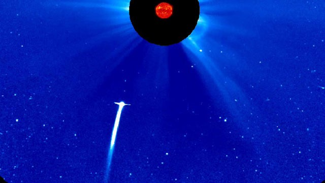 PHOTO: Comet Lovejoy plunging toward the sun, as seen by NASA's SOHO spacecraft. The image is in false color. The sun is blocked by a disc so that its light will not drown out everything around it.