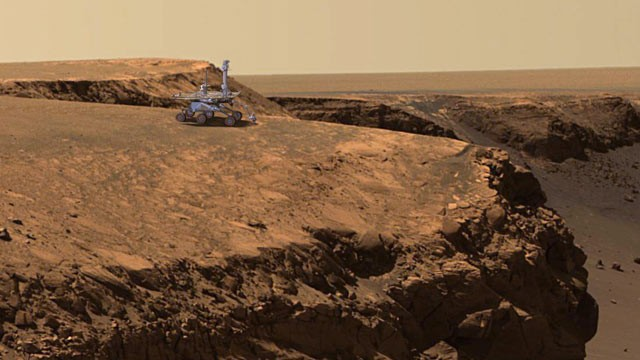 "PHOTO: An artist's concept of the Mars Exploration Rover Opportunity atop the ""Cabo Frio"" promontory on the rim of ""Victoria Crater'on Mars is shown to give a sense of scale."