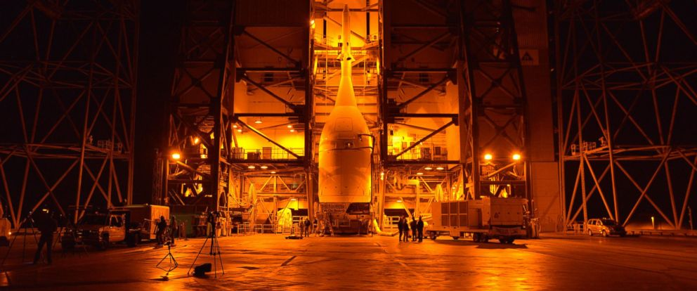 PHOTO: Engineers and technicians at Space Launch Complex 37 move Orion into place in the service structure so the spacecraft can be lifted and joined to the top of the Delta IV Heavy rocket on Nov. 12, 2014.