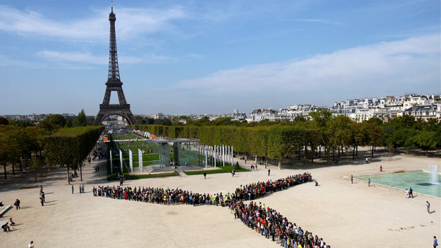 PHOTO: People power rivals the Eifel Tower in Paris, France as residents form a giant wind turbine with their bodies.