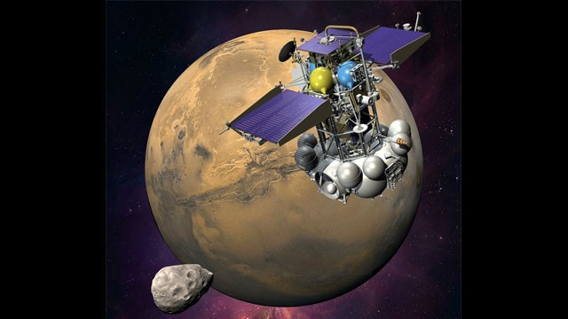PHOTO: An artist's concept of the Phobos-Grunt spacecraft nearing the Martian moon Phobos.
