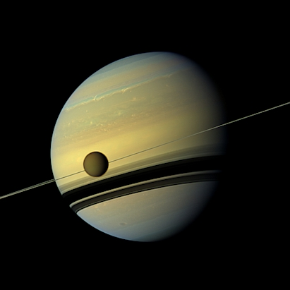 Saturn and moon Titan seen from Cassini Probe