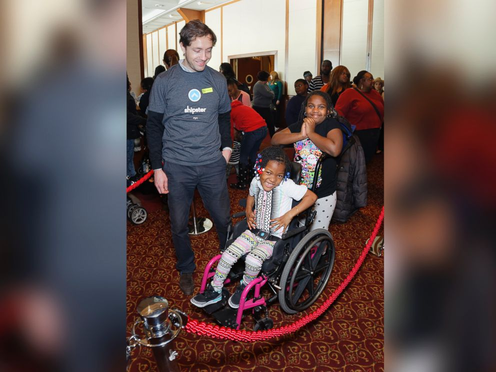 PHOTO: Shipster CEO Christian Vizcaino spends time with a family from New Alternatives for Children.