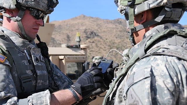 PHOTO:&nbsp;Soldiers using consumer smartphones during field exercises