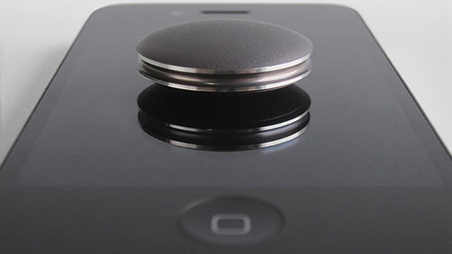 PHOTO: With the Misfit Shine you can tap it to an iPhone to pair it.