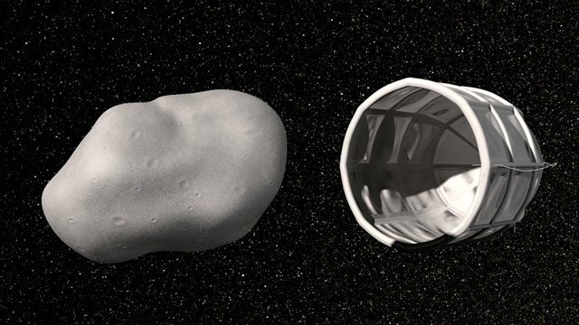 PHOTO: Computer rendition of a robotic spacecraft closing in on an asteroid to mine it for water or precious metals from Planetary Resources, Inc..