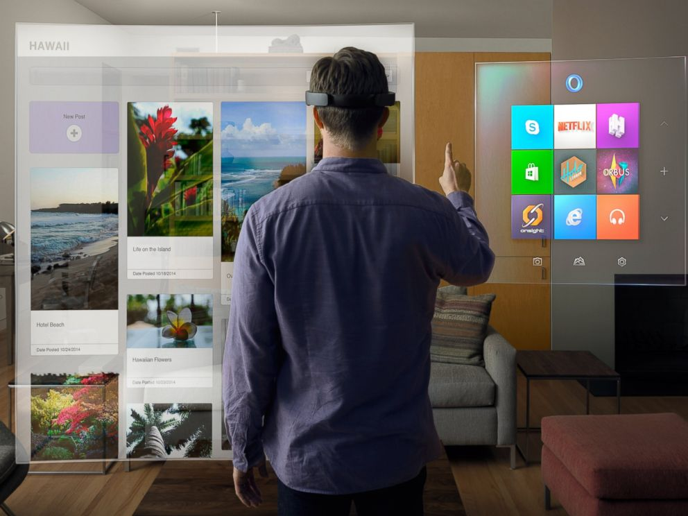 PHOTO: A handout image from Microsoft released on Jan. 21, 2014 shows a mock-up of the interface of the new HoloLens goggles that allows users to interact with applications through gesture and voice commands.