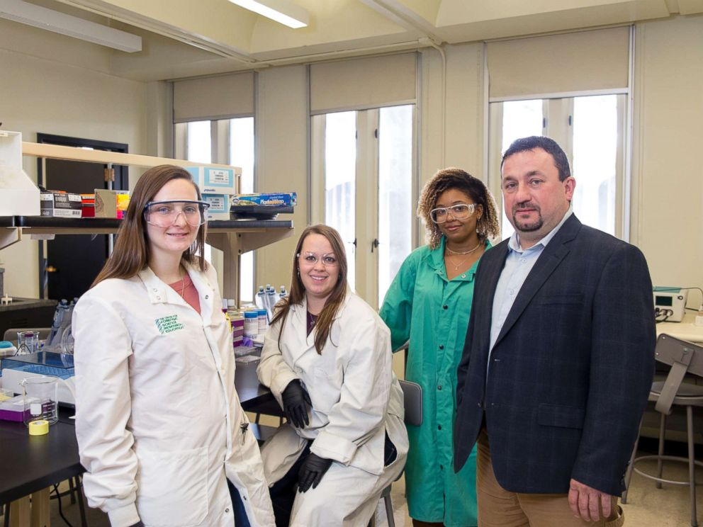 PHOTO: Assistant Professor Jan Halamek, Ph.D, working with Erica Brunelle, 4th year Chemistry PhD candidate; Mindy Hair, 2nd year Chemistry PhD candidate; and Adrianna Mathis 18 Chemistry, Nov. 2, 2017.