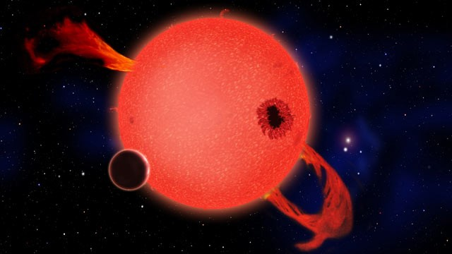 PHOTO: When its young, a red dwarf star frequently erupts with strong ultraviolet flares as shown in this artists conception;  scientists have calculated that six percent of red dwarf stars probably have Earth-size planets orbiting them.