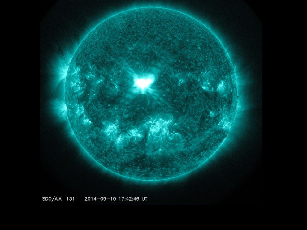 PHOTO: An X1.6 class solar flare flashes in the middle of the sun on Sept. 10, 2014. This image was captured by NASAs Solar Dynamics Observatory and shows light in the 131 Angstrom wavelength, which is typically colorized in teal.