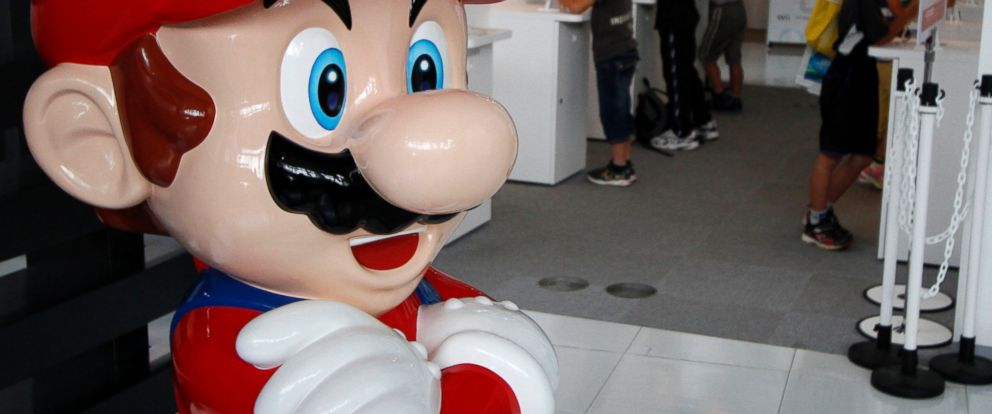 """PHOTO: """"Mario"""", a character in Nintendo Co Ltds """"Mario Bros"""" video games, is seen at the companys showroom in Tokyo July 28, 2011."""