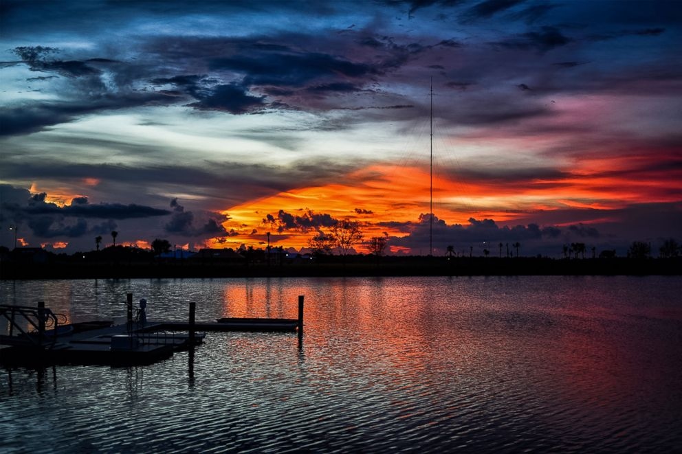 PHOTO: The sun sets over one of the lakes on the Babcock Ranch, a sustainable community, north of Fort Myers, Florida.