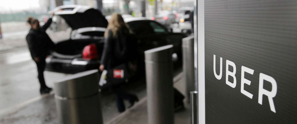 PHOTO: A sign marks a pick up point for the Uber car service at LaGuardia Airport in New York, March 15, 2017.