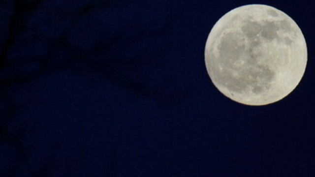VIDEO: Rare lunar occurrence coincides with ceremony to honor the first man on the moon.