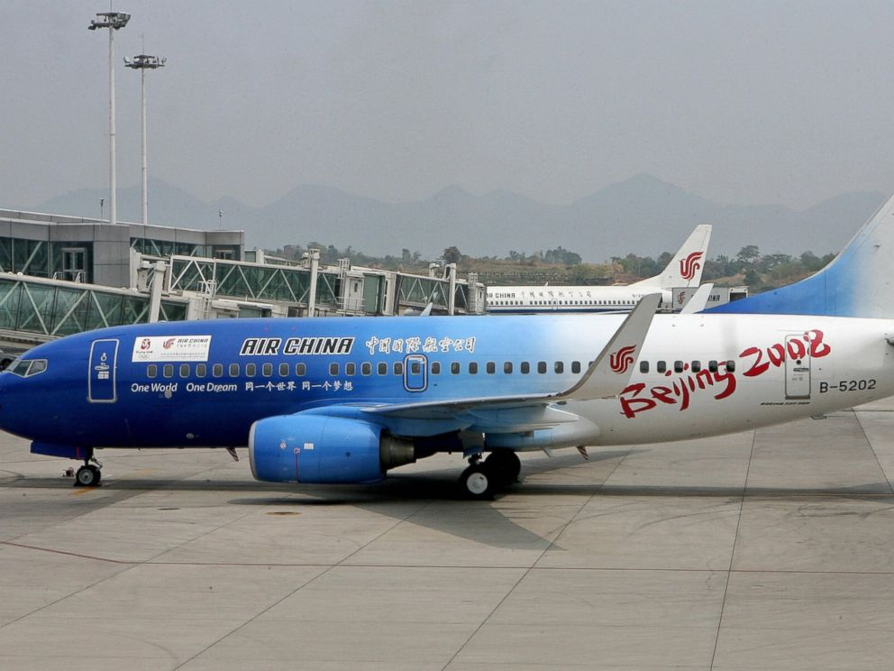 PHOTO: An Air China Boeing 737 jet painted to promote the Beijing 2008 Olympic Games, prepares to leave Chongqing airport, Aug. 20, 2006.