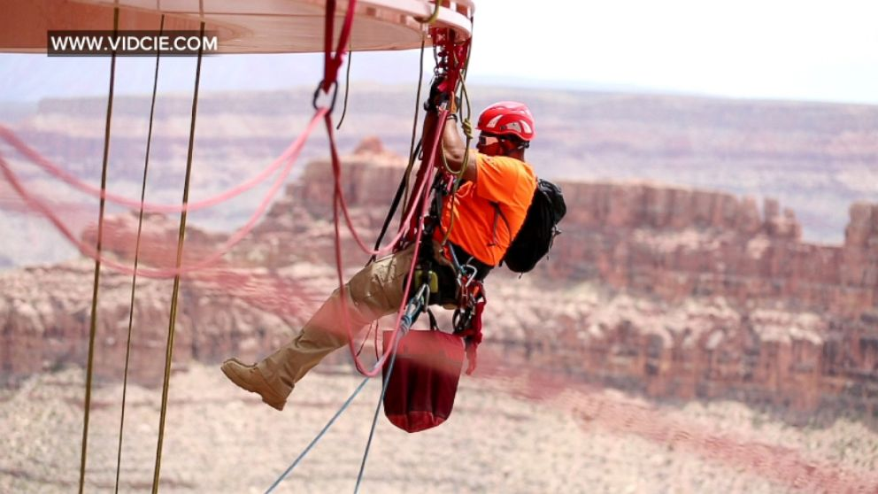 VIDEO: The Grand Canyon Skywalk doesnt clean itself, but thankfully these technicians are up to the task.