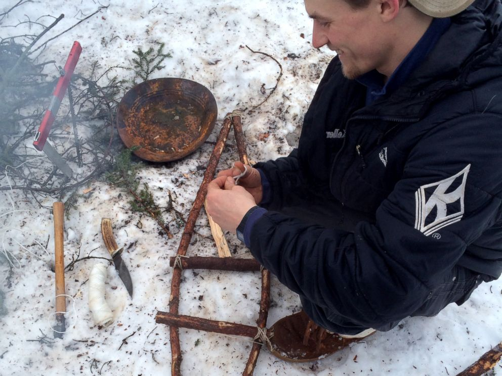 PHOTO: Dallas Seavey shows how to make snowshoes out of tree branches.
