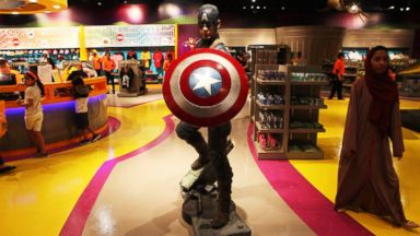 PHOTO:An Emirati woman walks past a statue of Captain America at the IMG Worlds of Adventure amusement park in Dubai, United Arab Emirates.The indoor theme park opened August 31,2016.
