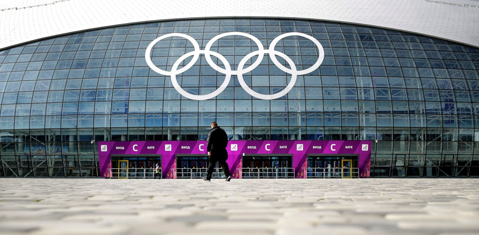 PHOTO: A man walks toward the Bolshoy Ice Dome, which is venue for Ice Hockey matches ahead of the 2014 Winter Olympics, Feb. 5, 2014, in Sochi, Russia.
