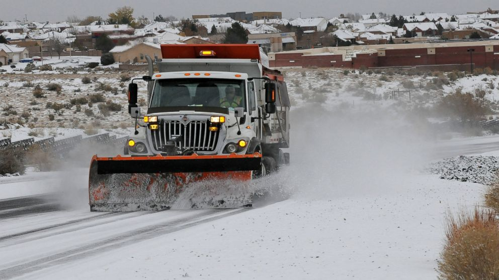 PHOTO: A plow and sanding truck clears a road after a winter storm hit New Mexico, making driving difficult in Albuquerque, N.M., Nov.24, 2013.