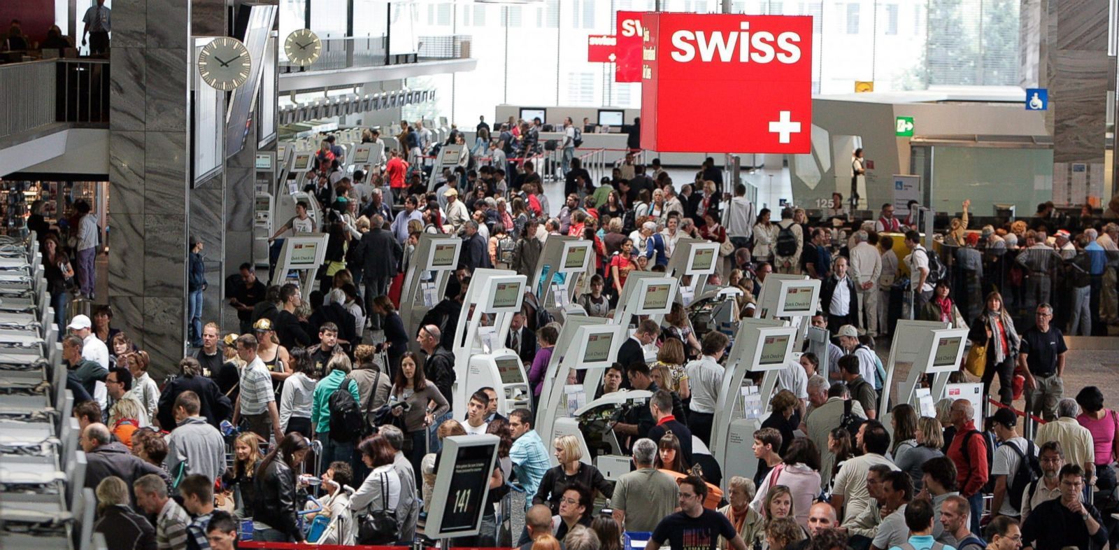 PHOTO: Passengers gather at the Zurich Airport in Kloten, Switzerland, July 11, 2009.
