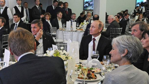 PHOTO: Russian President Vladimir Putin, center right, and then retired U.S. Army Lieutenant General Michael T. Flynn, center left, attend an exhibition marking the 10th anniversary of RT (Russia Today) TV news channel in Moscow, Russia, Dec. 10, 2015.
