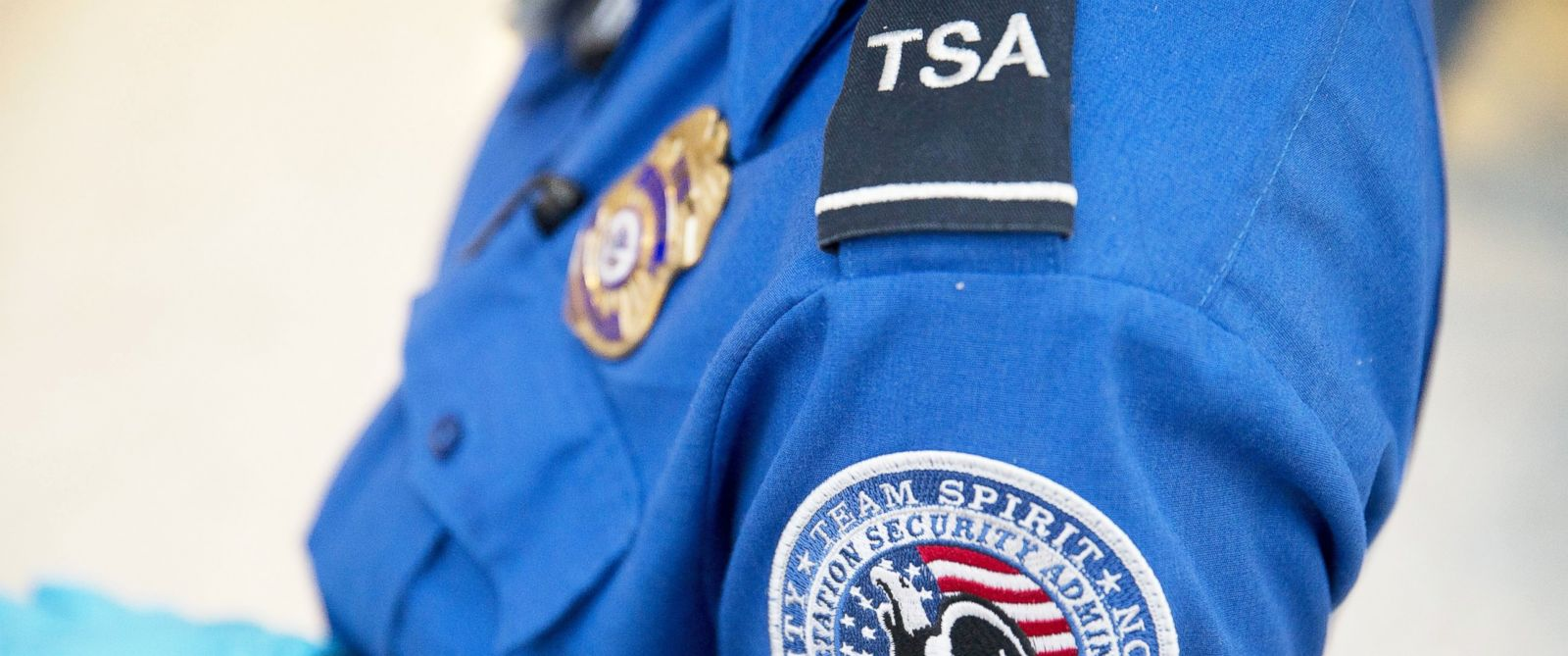PHOTO: A Transportation Security Administration officer stands in the pre-check area at Dulles International Airport in Dulles, Va., Aug. 19, 2015.