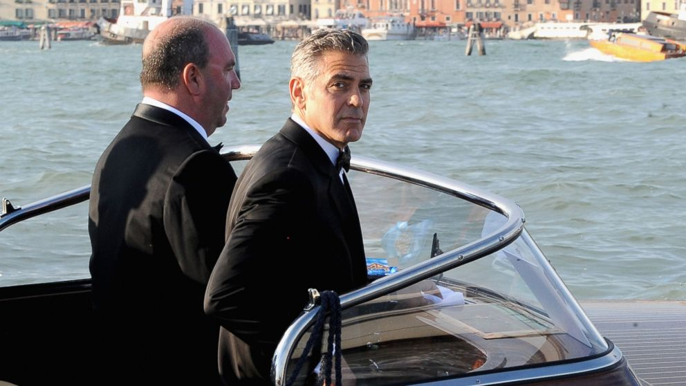 PHOTO: George Clooney, right, is seen during the 70th Venice International Film Festival on Aug. 28, 2013 in Venice, Italy.