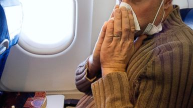 PHOTO: A man with influenza on airplane.