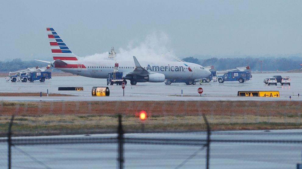 PHOTO: Crews spray deicing solution onto an American Airlines 737 before departure at Dallas-Fort Worth International airport, Nov. 25, 2013.