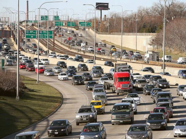 'PHOTO:Traffic backs up on the Kennedy Expressway as commuters and holiday travelers try to get an early start on their Thanksgiving travel in this file photo, Nov. 27, 2013, in Chicago.' from the web at 'http://a.abcnews.com/images/Travel/GTY_holidaytraffic_chicago_mm_151123_4x3_608.jpg'
