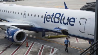 PHOTO: A flight crew member inspects a plane at at John F. Kennedy International Airport airport in New York, Aug. 7, 2015.