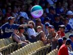 PHOTO: Young Los Angeles Dodgers fans toss around an inflatable beach ball