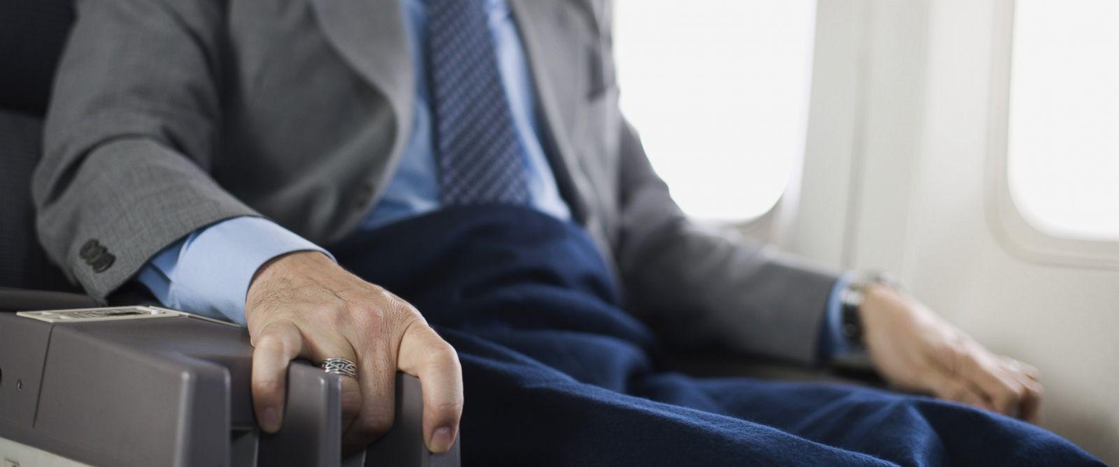 PHOTO: Nervous passenger sitting on airplane