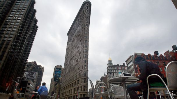 PHOTO: People sit on the recently constructed pedestrian plaza in front of the Flatiron Building