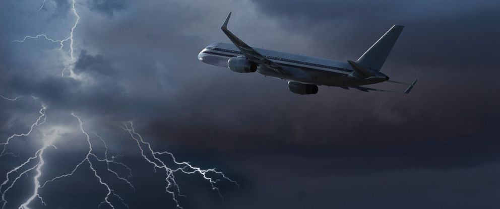 PHOTO: In this stock image, a plane is pictured flying during a lightning storm.