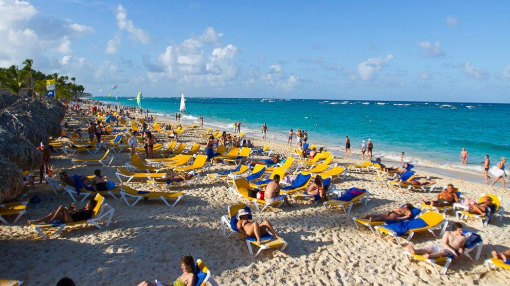 PHOTO: Tourists go for a walk at Bavaro beach in Punta Cana, Dominican Republic, Jan. 16, 2012.