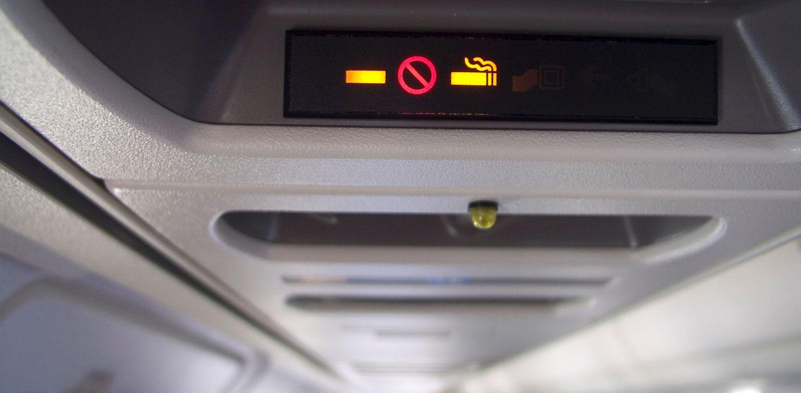 PHOTO: cigarette, smoking, airplane, travel
