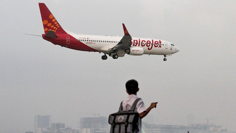 PHOTO: A SpiceJet Ltd. aircraft prepares to land at Chhatrapati Shivaji International Airport in Mumbai, India, Sept. 17,