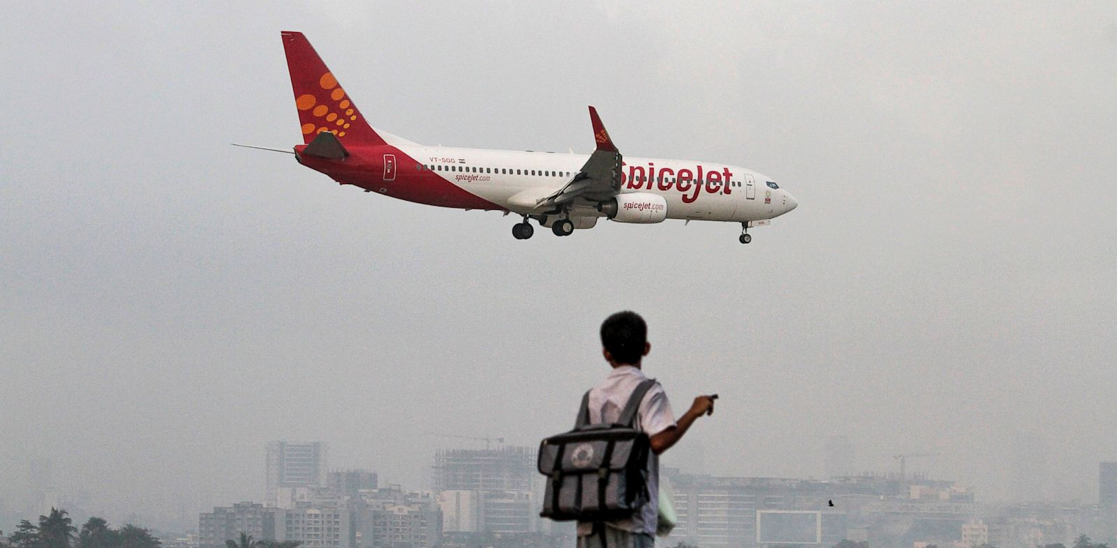 PHOTO: A SpiceJet Ltd. aircraft prepares to land at Chhatrapati Shivaji International Airport in Mumbai, India, Sept. 17, 2012.