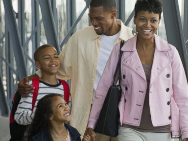 PHOTO: A family is pictured walking in an airport in this stock image.