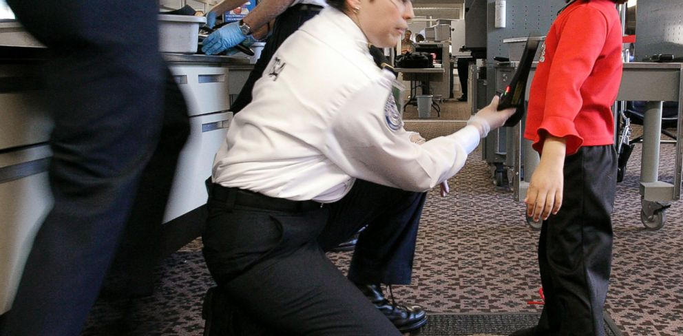 PHOTO: A TSA agent performs a pat-down check on a young girl at a security checkpoint at Phoenix Sky Harbor International Airport, December 2004, in Phoenix.