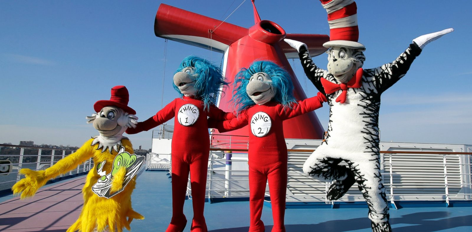 PHOTO: Dr. Seuss characters explore the ship after a media event to unveil an exclusive partnership to bring the childrens brand and characters to Carnivals fleet of 24 ships, aboard the Carnival Splendor docked in New York, Dec. 11, 2013.