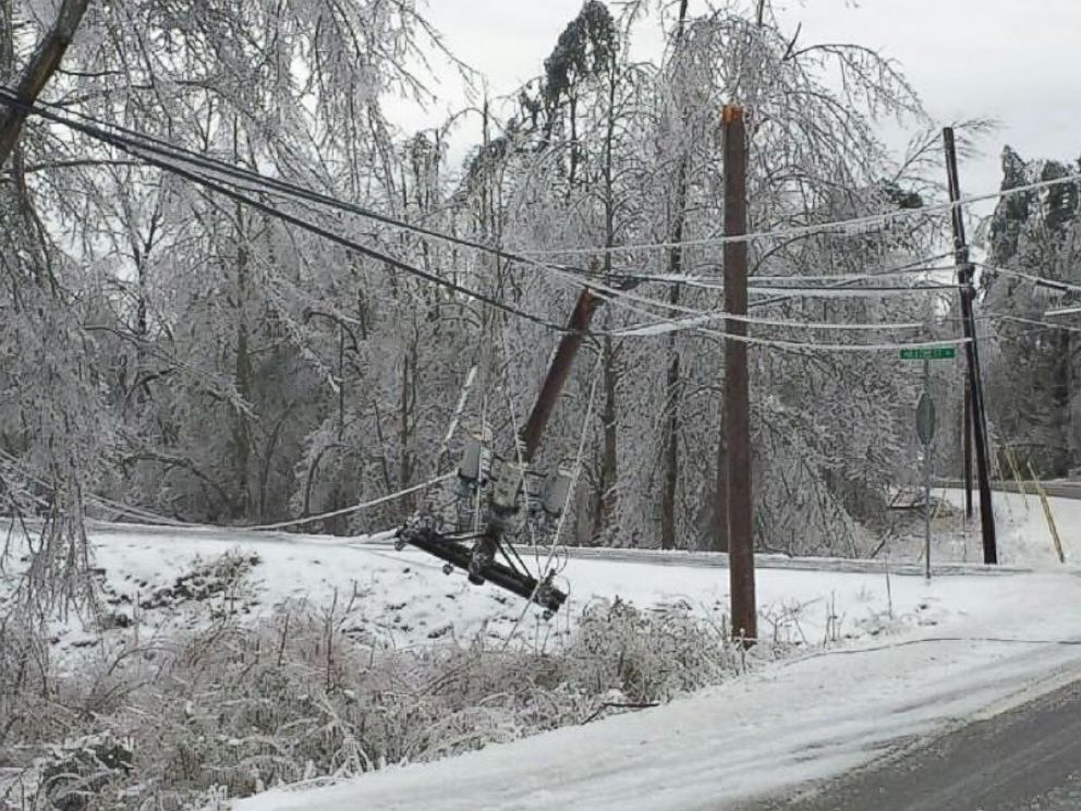 PHOTO: Significant icing across Monterey, Tenn. weighed down trees and snapped power lines blocking roads in the area.