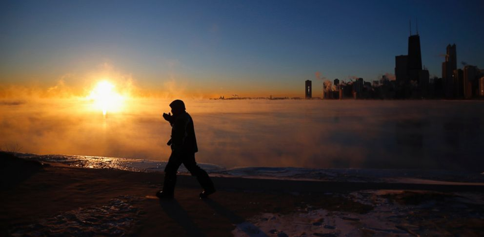 PHOTO: A man is silhouetted against the fog off Lake Michigan in Chicago, Ill., Jan. 28, 2014.
