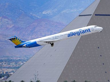 PHOTO: In this May 9, 2013, photo, an Allegiant Air jetliner flies by the Luxor Resort & Casino after taking off from McCarran International Airport in Las Vegas. Allegiant Air has been profitable for 10 straight years.