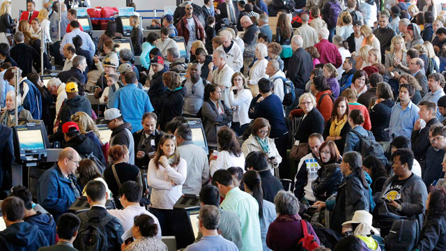 PHOTO: Passengers gather at the American Airlines check-in for flights at Los Angeles International Airport, April 16, 2013.