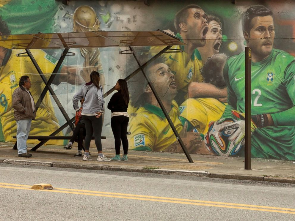 PHOTO: A mural of Brazilian soccer player Neymar, right, and others cover a wall by a bus stop in Sao Paulo, Brazil, May 26, 2014.