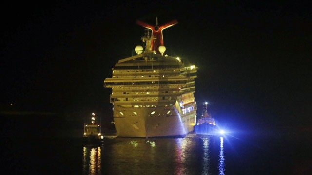 PHOTO: The cruise ship Carnival Triumph is towed up the Mobile River in Mobile, Ala., Thursday, Feb. 14, 2013. The ship with more than 4,200 passengers and crew members has been idled for nearly a week in the Gulf of Mexico following an engine room fire.