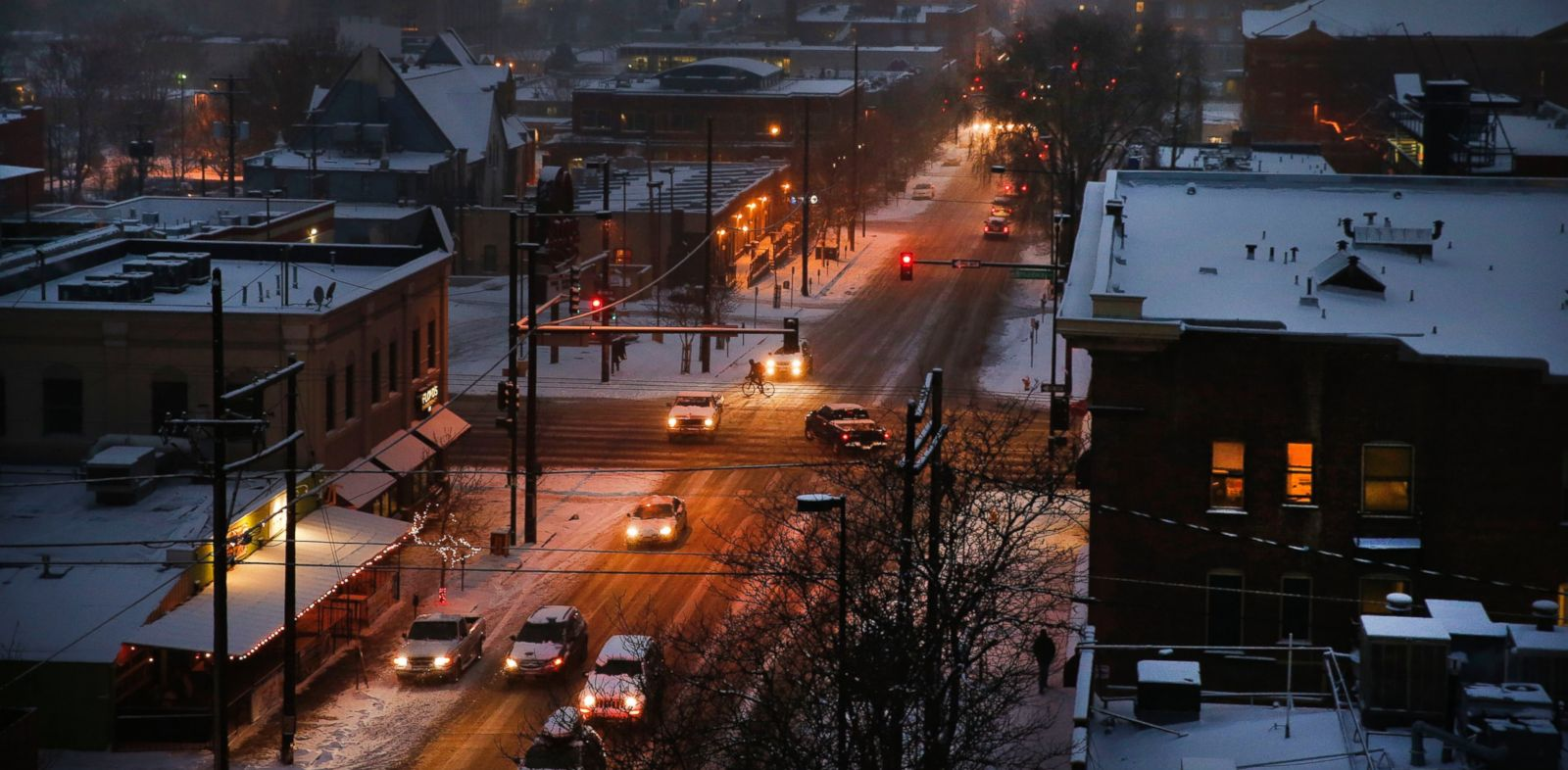 PHOTO: As night falls, rush hour begins in seven degree weather, in downtown Denver on Dec. 4, 2013.